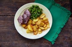 Patatas y habas de la carne Fotos de archivo