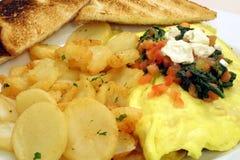 Patatas y tortilla de huevos del desayuno Fotografía de archivo libre de regalías