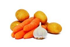 Patatas, zanahorias y ajo fotos de archivo libres de regalías