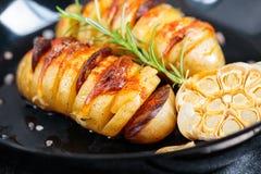 Patate al forno del hasselback Immagini Stock