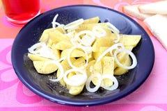 Patate con le cipolle Fotografia Stock
