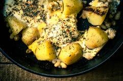 Patate con le uova fritte Immagini Stock