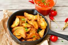 Patate dei cunei e sause del ketchup Fotografie Stock