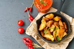 Patate dei cunei e sause del ketchup Immagine Stock Libera da Diritti