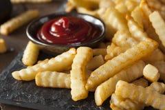 Patate fritte al forno non sane della piega fotografia stock