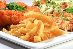patate fritte con carne Fotografia Stock