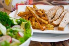 Patate fritte con carne Fotografie Stock