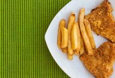 Patate fritte con carne di pollo Fotografie Stock