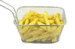 Patate fritte in friggitrice Fotografie Stock