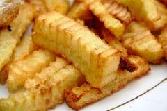 Patate fritte sulla zolla bianca Fotografia Stock Libera da Diritti