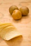 Patatine fritte e patata cruda Fotografia Stock Libera da Diritti