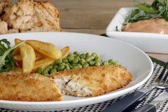 Patatine fritte e piselli dei pesci Fotografia Stock
