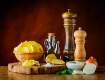Patatine fritte ed ingredienti Immagini Stock