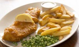 Patatine fritte & piselli del pesce fotografia stock