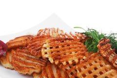 Patatine fritte servite sul piatto bianco Immagini Stock