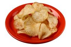 Patatine fritte sulla zolla rossa fotografia stock
