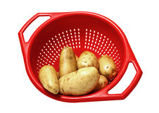 Patatoes in strainer Royalty Free Stock Photos
