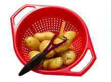 Patatoes in strainer Stock Photos