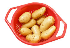 Patatoes in strainer Royalty Free Stock Photo