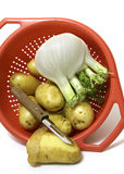 Patatoes in strainer Stock Image