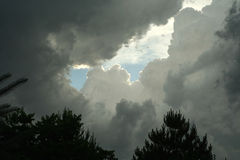 Patch of Blue. Gathering storm clouds; patch of blue sky; Beatrice, Nebraska Royalty Free Stock Image