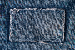 Patch on blue jeans Royalty Free Stock Image