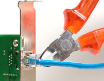 Patch cable in interface card, with pliers Stock Photography