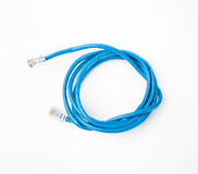 Patch cord network cable with molded RJ45 plug, isolated on a white background. Patch cord blue network cable with molded RJ45 plug, isolated on a white Stock Photo