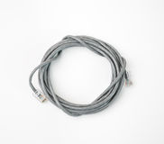 Patch cord network cable with molded RJ45 plug, isolated on a white background Royalty Free Stock Photos