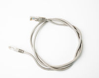 Patch cord network cable with molded RJ45 plug, isolated on a white background Royalty Free Stock Photography