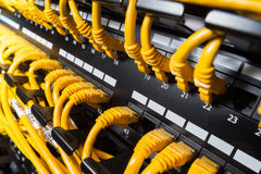 Patch panel. Close-up view on a patch panel with yellow network cables Stock Photo