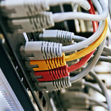 Patch Panel server rack with gray yellow and red  cords Stock Photo