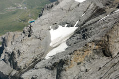 Patch of snow on the slope of Monch mountain if Alps in Jungfrau region Royalty Free Stock Photo