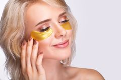 Free Patch Under Eyes. Beautiful Woman Face With Gold Hydrogel Patches, Lifting Anti-Wrinkle Collagen Mask On Fresh Healthy Facial Ski Stock Images - 119451474