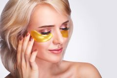 Free Patch Under Eyes. Beautiful Woman Face With Gold Hydrogel Patches, Lifting Anti-Wrinkle Collagen Mask On Fresh Healthy Facial Ski Stock Photography - 119451482