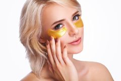 Free Patch Under Eyes. Beautiful Woman Face With Gold Hydrogel Patches, Lifting Anti-Wrinkle Collagen Mask On Fresh Healthy Facial Ski Stock Photos - 119451513
