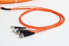 Patchcord arancio del connettore della st di fibra ottica Fotografia Stock