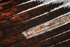 Patched boat. Patched side of a wooden boat in winter storage Royalty Free Stock Images