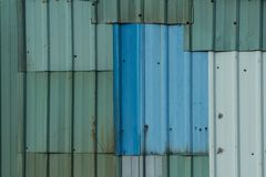 Patched Corrugated Metal Sheet. Royalty Free Stock Photos
