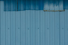Patched Corrugated Metal Sheet. Stock Image