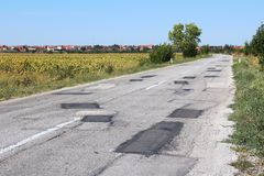 Patched road. Poorly patched road in Negotin, Serbia. Regional road in Bor district of Serbia. Serbian countryside Stock Image