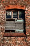 The patched up old window. Stock Photo