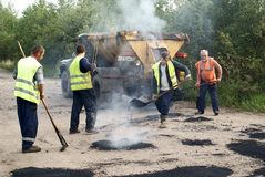 Patching repair dirt road. In the Russian province Royalty Free Stock Photos