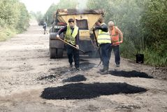 Patching repair dirt road. In the Russian province Royalty Free Stock Image