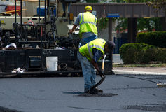 Patching road with hot asphalt Royalty Free Stock Image