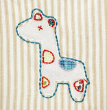 Patchwork. A macro shot of a patchwork design of a giraffe on a blanket Stock Illustration