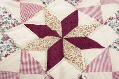 Patchwork. Traditional hand made patchwork detail of a blanket Royalty Free Stock Photos