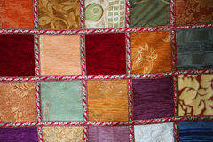 Patchwork as background. A colorful handmade patchwork quilt as background Royalty Free Stock Image