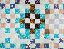 Patchwork background. Patchwork quilt background with different colors mostly blue Royalty Free Stock Photography