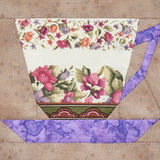 Patchwork block of the cup with a pattern of flowers Stock Image